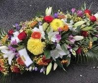 colourful coffin spray