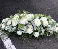 white coffin spray